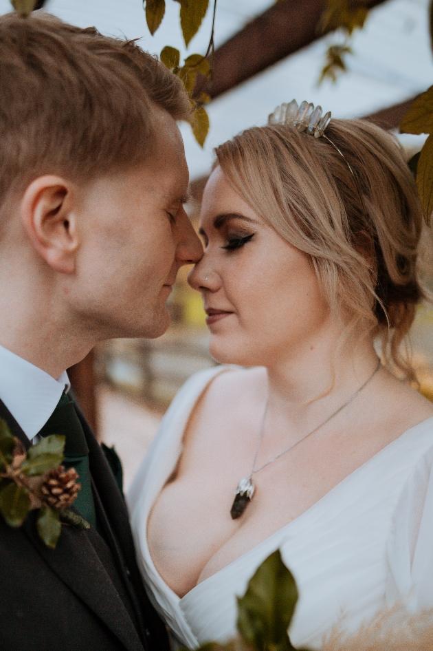 Couple pose for wedding photos