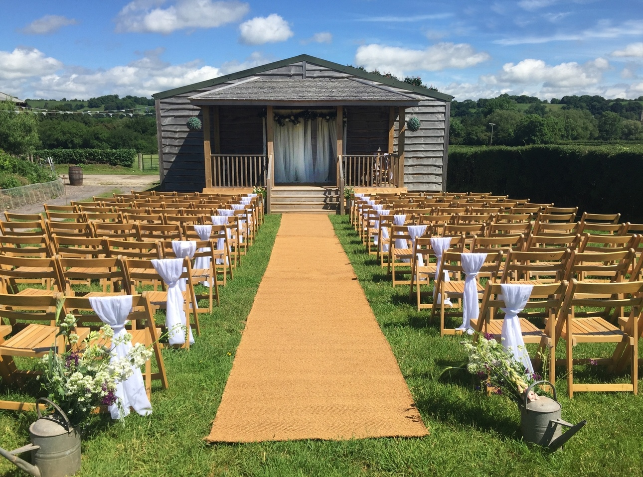 Outdoor ceremony set up at Somerset wedding venue The Barn at Cott Farm