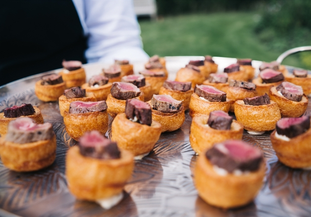 Mini Yorkshire pudding canapés served by waiting staff at wedding.