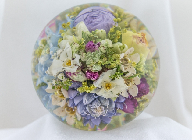 Wedding flowers preserved in glass paperweight by Flower Preservation Workshop