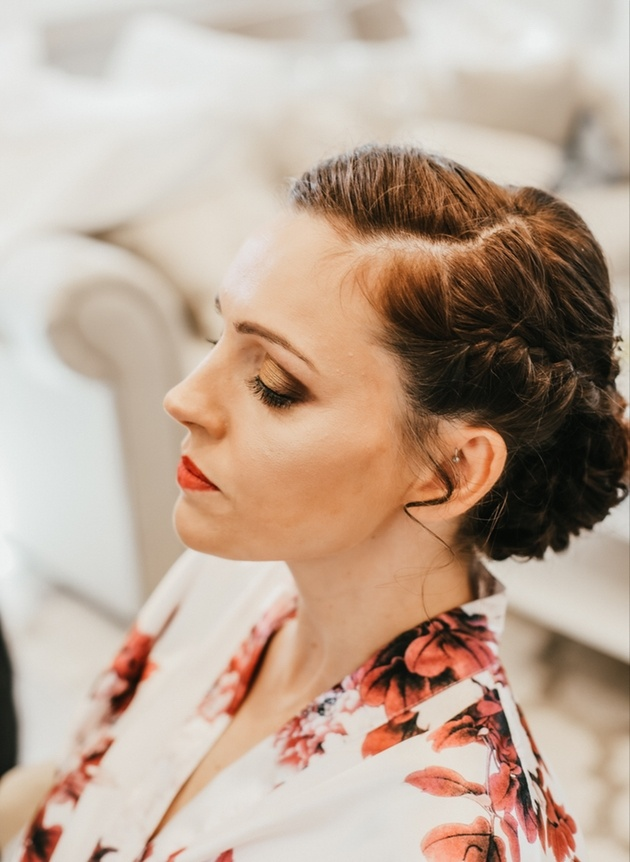 Bride getting ready in the morning with make up and floral robe
