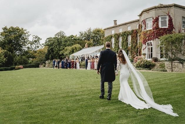 Couple walking in venue garden