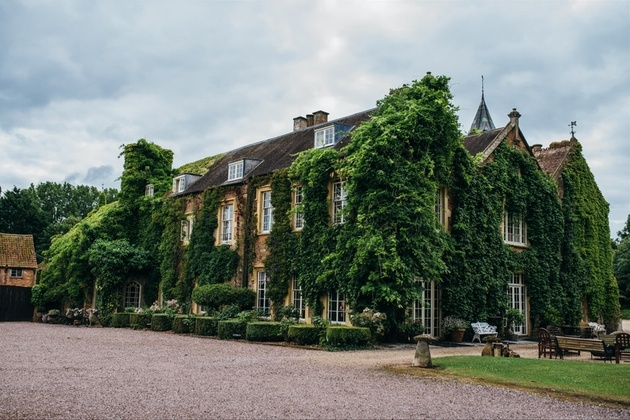 Exterior of Maunsel House wedding venue covered in wisteria.