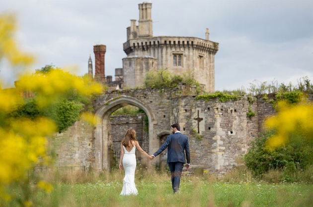 Exterior of Thornbury Castle with newlyweds