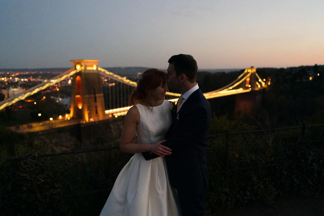 Couple pose infront of the Clifton bridge
